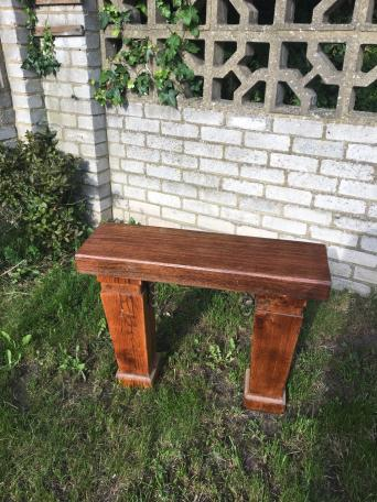 this solid piece of garden furniture is made from hard wood the seating area is a railway sleeper a beautiful hardwood possibly mahogany or jarra the