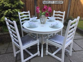 Round Extending Dining Table 4 Chairs Upholstered In Grey