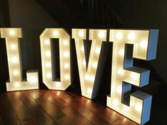available to hire only make your wedding stand out with these beautiful 4ft high love letters the warm white cabochon bulbs create a lovely effect on the
