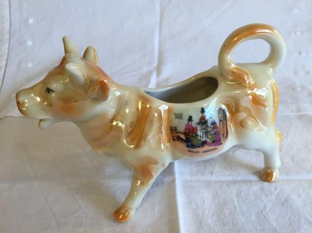 Preview of the first image of Cow creamer jug - 'Welsh costume' souvenir - perfect.