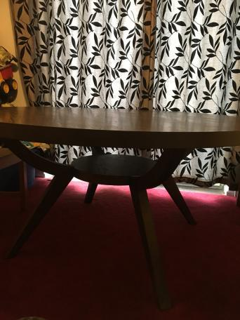 A Large Wooden Circular Dining Room Table With Beautiful Display Shelf Underneath Perfect For Displaying Fancy Chess Set Example