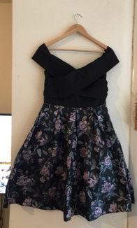 Preview of the first image of Off the shoulder chi chi London dress.