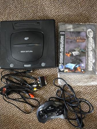 Image 1 of sega Saturn console with game.