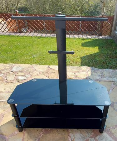 Image 1 of 50 inch black TV stand with mounting bracket