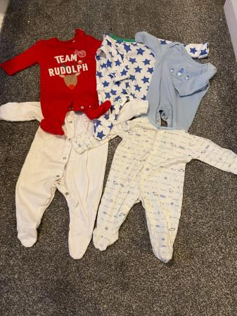 Image 9 of Reborn doll and clothes bundle