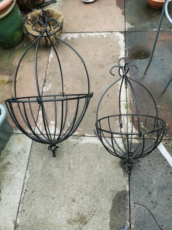 Image 1 of 1 large 1 small hanging basket