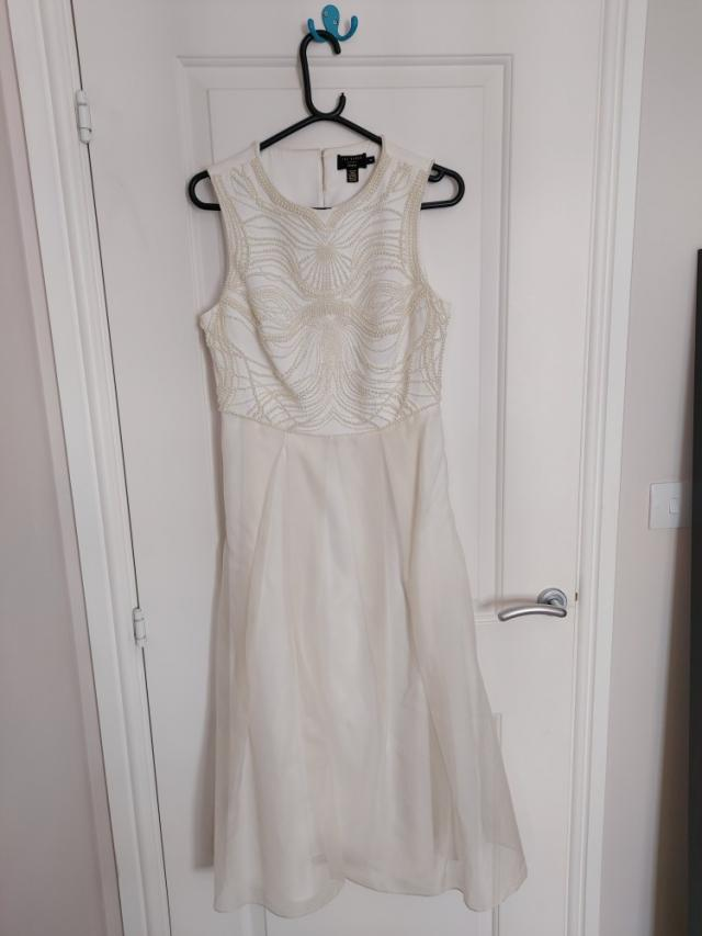 Preview of the first image of Ted Baker Silk Dress for sale. Size 12-14..