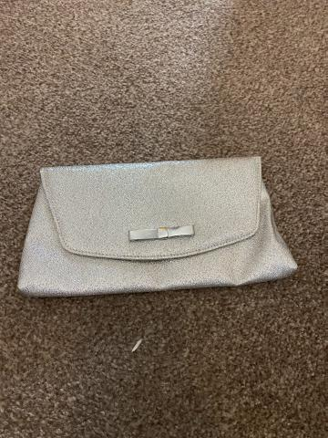 Preview of the first image of Silver clutch bag.