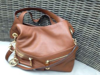 Michael kors genuine tan bag. This advert is located in ... f76db649580c8