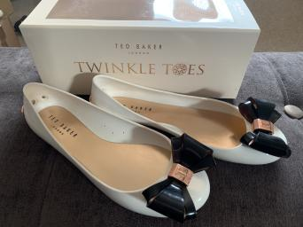 9069f47af Brand new in box  unworn Ted Baker size 6 Julivia Twinkle Toes cream  black  jelly bow shoes with rose gold accents Collection only