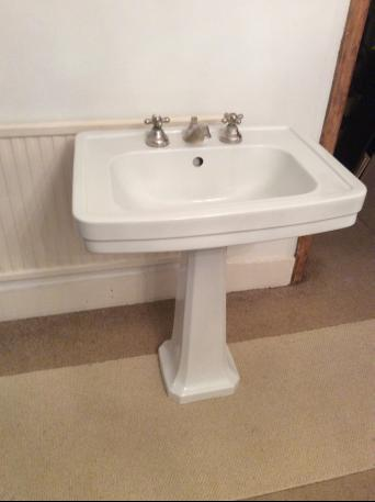 Ceramic bathroom sink with brass taps for sale. Used, but in excellent condition. Basin measures 670mm x 490mm Pedestal is 650mm high