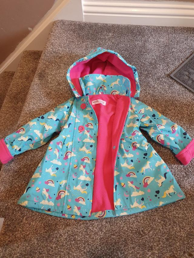 Preview of the first image of girls minoti rain coat age 1-2yrs.