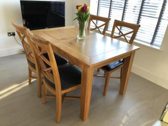 A Beautiful Extendable Dining Table In High Quality Wood Along With Soft Luxurious 4 Leather Chairs Bought From Furniture Village And Barely Used