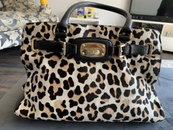 e5f11d00bb1a This bag is very unusual and stunning. Material is leather with calf hair  on the front - short and long handle. Hardly used but the gold coloured  joins are ...