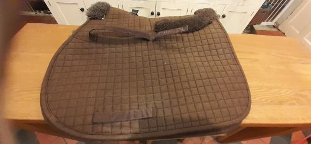 Preview of the first image of Caldene Full Size sheepskin saddle pad.