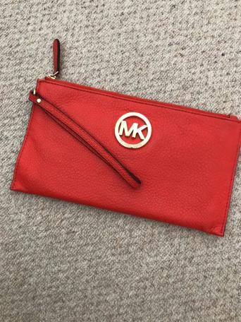 01a9d3826209c7 Beautiful leather orange Michael Kors clutch bag. Handle loop. Gold metal  symbol has faint scratches but you need to look very closely. Only used a  few ...
