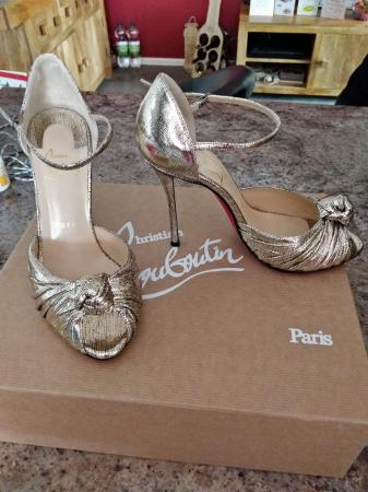 huge discount bde63 ca0d5 Genuine Christian Louboutin gold evening shoes Size 37