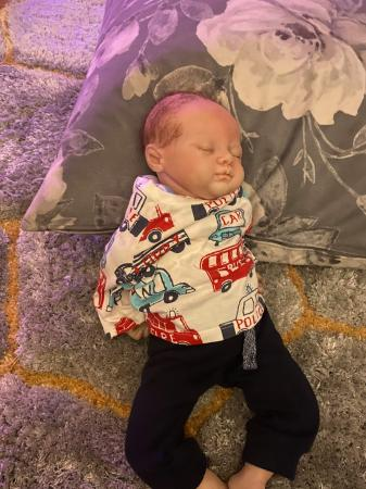 Image 1 of Reborn doll and clothes bundle